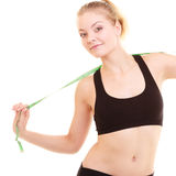 Diet. Fitness woman fit girl with measure tape Stock Image