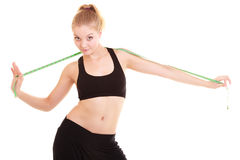 Diet. Fitness woman fit girl with measure tape Stock Photos