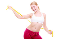 Diet. Fitness woman fit girl with measure tape isolated Royalty Free Stock Images