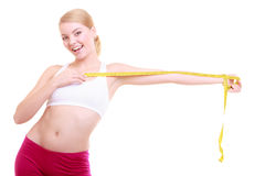 Diet. Fitness woman fit girl with measure tape isolated Royalty Free Stock Photography
