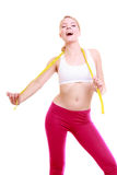 Diet. Fitness woman fit girl with measure tape isolated Stock Images