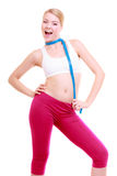 Diet. Fitness woman fit girl with measure tape isolated Stock Photography