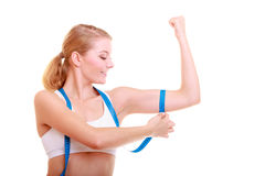 Diet. Fitness woman fit girl with measure tape measuring her biceps Stock Photography