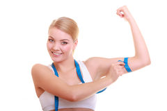 Diet. Fitness woman fit girl with measure tape measuring her biceps Stock Images