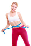 Diet. Fitness woman fit girl with measure tape measuring her waist Royalty Free Stock Images