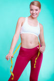 Diet. Fitness woman fit girl with measure tape measuring her waist Stock Photos