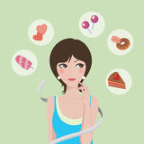 Diet or food. Girl hesitant while facing the sweet foods Stock Images