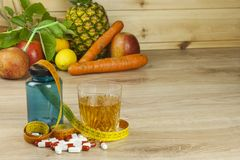 Diet food, apple juice, vegetables and fruits, concept diet, vitamin supplements Royalty Free Stock Photo