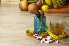 Diet food, apple juice, vegetables and fruits, concept diet, vitamin supplements Stock Image