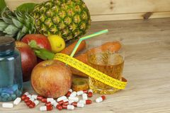 Diet food, apple juice, vegetables and fruits, concept diet, vitamin supplements Stock Photo