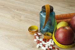 Diet food, apple juice, vegetables and fruits, concept diet, vitamin supplements Royalty Free Stock Images