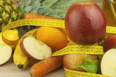 Diet food, apple juice, vegetables and fruits, concept diet, vitamin supplements Stock Photos