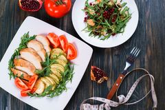 Diet food, chicken meat for dieting, proteins, healthy  low-calo. Rie meals concept. Baked chicken breasts with zucchini, chicken salad with pomegranate seeds Stock Photos