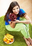 Diet food concept. Woman sitting on a floor Stock Photos