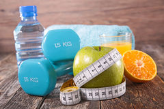 Diet food and fitness. On wood Royalty Free Stock Images