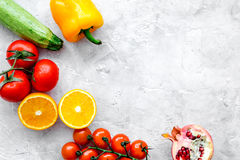 Diet food with fresh fruits and vegetables salad stone background top view mockup Royalty Free Stock Photos