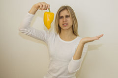 Diet food. girl pointing with hand on copy space for product Stock Images