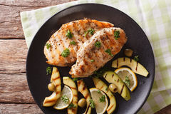 Diet Food: Grilled chicken breast with avocado, lemon and olive Stock Images