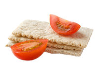 Diet food, healthy cereal bread. And tomato isolated in white royalty free stock images