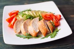 Diet food, proteins, healthy low-calorie meals concept. Baked ch. Icken breasts with zucchini, tomatoes and arugula, close up Royalty Free Stock Image
