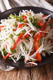 Diet food: salad of daikon with pepper and herbs closeup. vertic Royalty Free Stock Photography