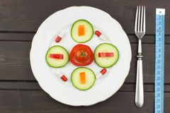 Diet food on a wooden table. Strict diet meals. Slimming diet. Stock Photo