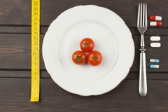 Diet food on a wooden table. Strict diet meals. Slimming diet. Royalty Free Stock Images