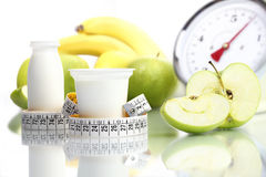 Diet food yogurt fruit Apple meter scales Royalty Free Stock Photography