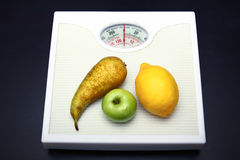 Diet. Fruit lies on scales and symbolizes healthy food stock image