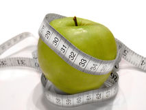 Diet fruit with measure tape (green apple) Stock Image