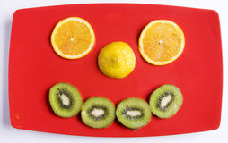 Diet fruit smile. Display of isolated fruits on a red tray Royalty Free Stock Photo