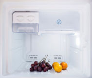 Diet fruit, some orange and grape put in the freezer fridge Royalty Free Stock Photography