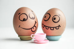 Diet. Funny eggs with painted face concept Stock Photos