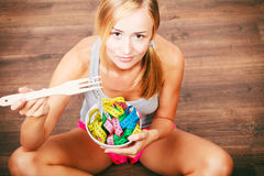 Diet. Girl with colorful measuring tapes in bowl Royalty Free Stock Photos