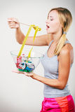 Diet. Girl with colorful measuring tapes in bowl Royalty Free Stock Image