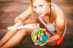 Diet. Girl with colorful measuring tapes in bowl Stock Photos