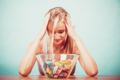 Diet. Girl with colorful measuring tapes in bowl Stock Photo
