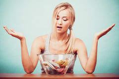 Diet. Girl with colorful measuring tapes in bowl Stock Images