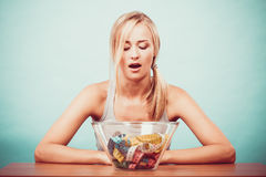 Diet. Girl with colorful measuring tapes in bowl Royalty Free Stock Photography