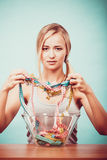 Diet. Girl with colorful measuring tapes in bowl stock image