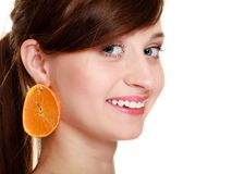 Diet. Girl with earrings of orange fruit isolated Royalty Free Stock Photos