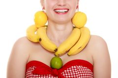 Diet. Girl with fruit necklace and earrings Stock Photos