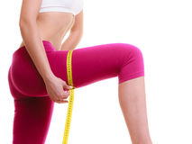 Diet. Girl with measure tape measuring thigh Royalty Free Stock Images