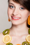 Diet. Girl with necklace of fresh citrus fruits Royalty Free Stock Photography