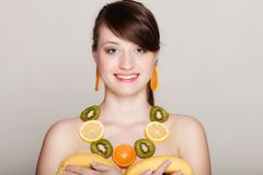 Diet. Girl with necklace of fresh citrus fruits Stock Photography