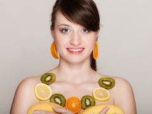 Diet. Girl with necklace of fresh citrus fruits Stock Photo