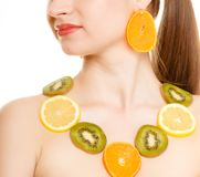 Diet. Girl with necklace of fresh citrus fruits is Royalty Free Stock Images