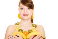 Diet. Girl with necklace of fresh citrus fruits isolated Royalty Free Stock Photos