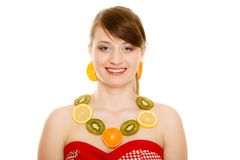 Diet. Girl with necklace of fresh citrus fruits is Royalty Free Stock Photos