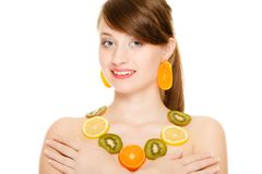 Diet. Girl with necklace of fresh citrus fruits isolated Stock Photography